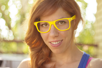 Portrait of a hipster girl with big glasses