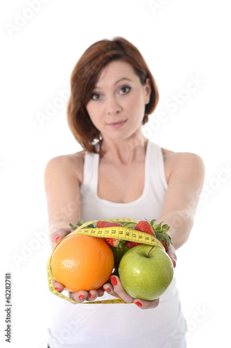 woman hands with fruit  bond with measure tape slave to diet con