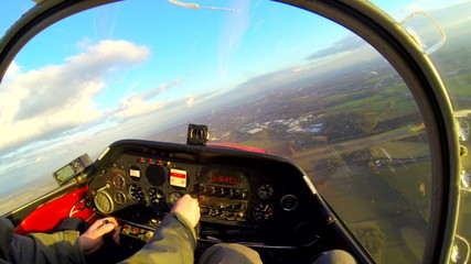 Flying in a small prop plane over countryside aerial views