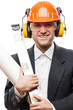 Businessman in safety hardhat helmet holding paper drawings plan