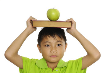 schoolboy books and apple in the head
