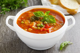 Fototapety Bowl of minestrone soup with bread
