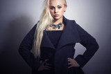 Beautiful Blond Woman in Topcoat.Jewelry.Spring Shopping