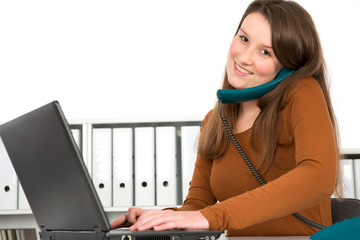 young businesswoman calling and working with the computer