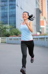 healthy lifestyle woman jogging at city foot bridge