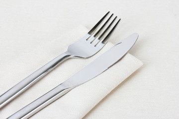 fork and knife on napkin isolated on white