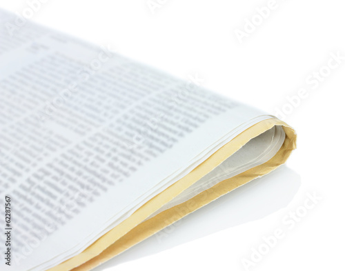 Roll of newspaper isolated on white.