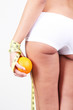 Beautiful young woman with orange and measuring tape