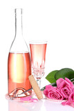 Composition with pink sparkle wine in glass, bottle and pink