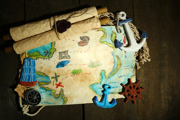 Old paper with sea accessories, isolated on wooden background
