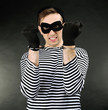 Thief with handcuffs on dark background