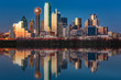 Leinwandbild Motiv Dallas skyline reflected in Trinity River at sunset