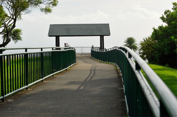 Metal railing surrounds a walkway to a lookout