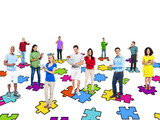 Group Of Multi-Ethnic People Standing On Jigsaw Puzzle