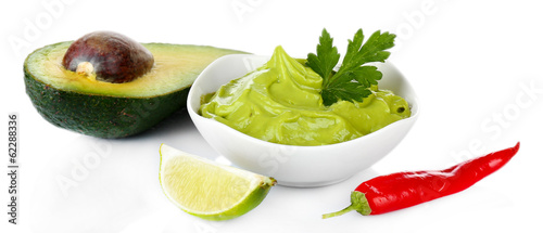 Fresh guacamole in bowl isolated on white
