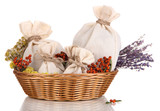 Textile sachet pouches with dried flowers, herbs  and berries