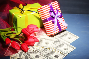 Gift box with money and flowers