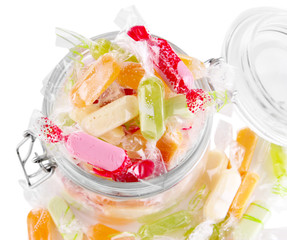Tasty candies in jar isolated on white