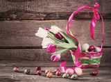 tulips and easter eggs on wooden background