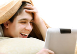 Teenager with Tablet in the Bed