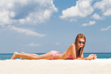 Young  woman lying on an exotic beach