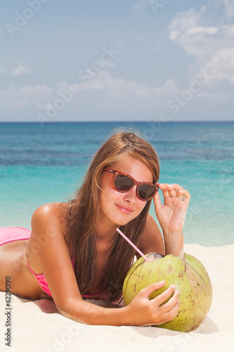 Beautiful girl is drinking coconut