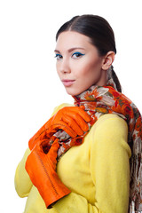 Beautiful young woman in scarf and gloves