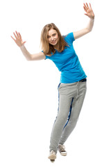 Playful young woman balancing tilted sideways