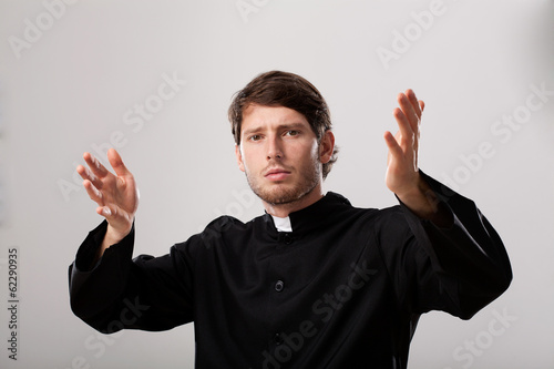 Priest is preaching a sermon