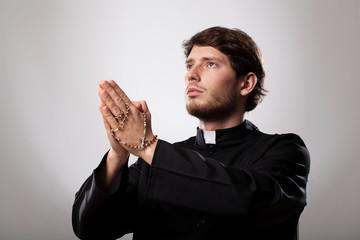 Priest is praying
