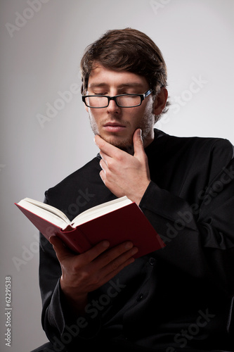 Priest is reading