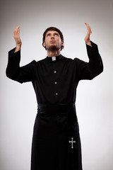Priest raising hands and praying