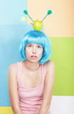 Woman with Apple on her Blue Haired Head. Series of Photos
