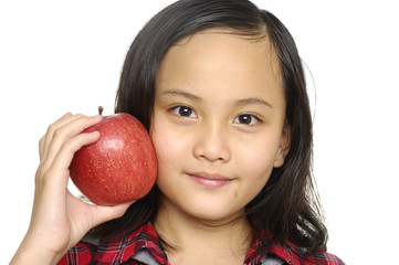 Close up little girl holding apple