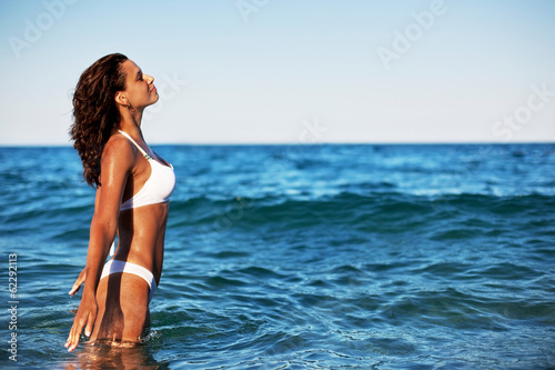 Young woman enjoying summer rest at the seaside.