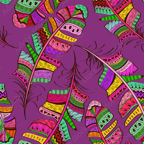 Seamless pattern of tribal ornate bird feathers