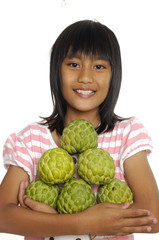 Close up little girl holding custard apple