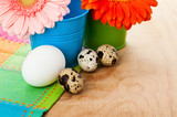 Easter setting with quail eggs and gerberas
