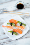 Sushi set with salmon, shrimp and avocado, vertical shot