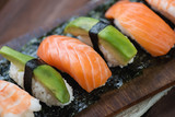 Close-up of sushi with salmon, shrimp and avocado