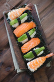 Above view of a sushi set, rustic wooden background