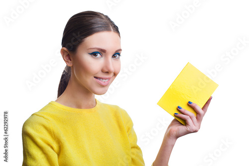 Beautiful woman holding yellow blank
