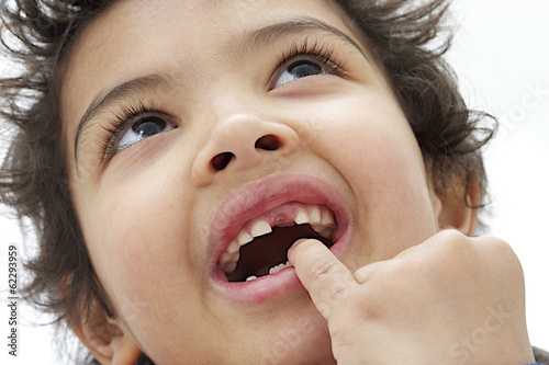 child boy hand showing the temporary tooth pointing