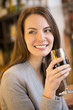 Portrait of pretty young woman drinking red wine in restaurant
