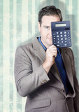 Business person hiding behind cash calculator