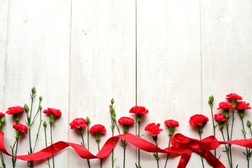 Red carnations with ribbon