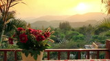 Sunset among moutains in front of romantic dinner at home