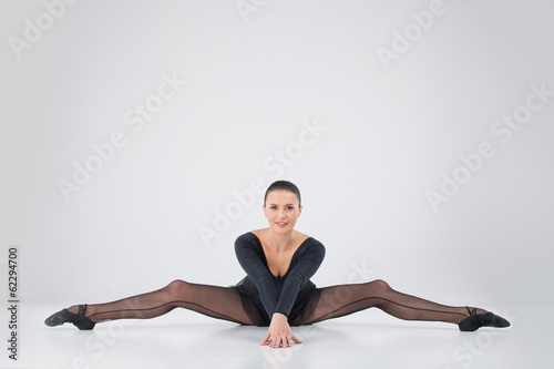 beautiful girl doing side split.
