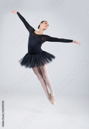 attractive dancer jumping and practicing dance.