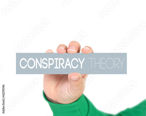 woman holding a label with  Conspiracy theory